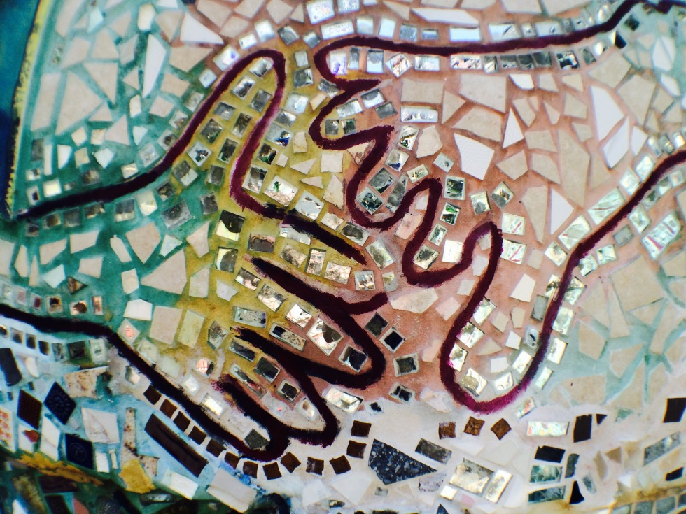 mosaic tile art depicting two hands reaching out to each other